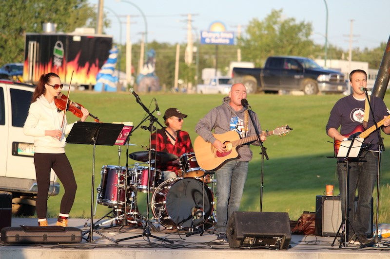 """From left to right, Jennifer Nyhof, Kory Wickdahl, Karl Bennett and Justin Fuciarelli closed out the 2019 Concert in the Park series Aug. 21 with their take on rock-country hits like """"The Joker"""" and """"Wagon Wheel."""""""
