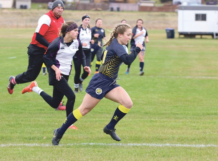 Mikayla Frattinger in the first-ever game on BU's Rugby field