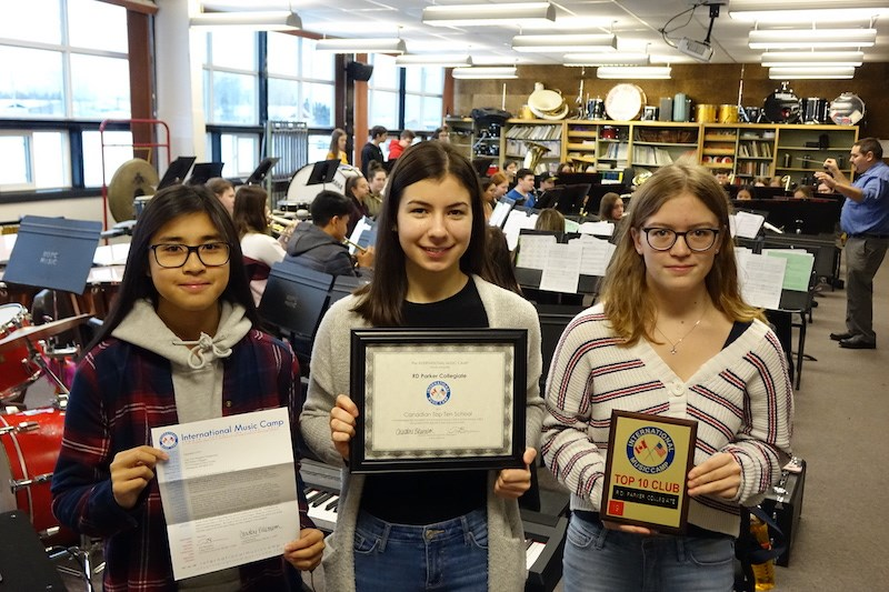 From left to right, Nicole Cruda, Kendra Martinussen and Carissa Kennedy with a letter, certificate