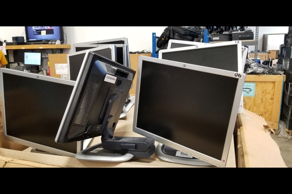 Desktop computers and monitors refurbished by Computers for Schools are being donated to Manitoba residents, including some in Flin Flon, Thompson and Marcel Colomb First Nation, by Tech Manitoba, with shipping provided by Gardewine.