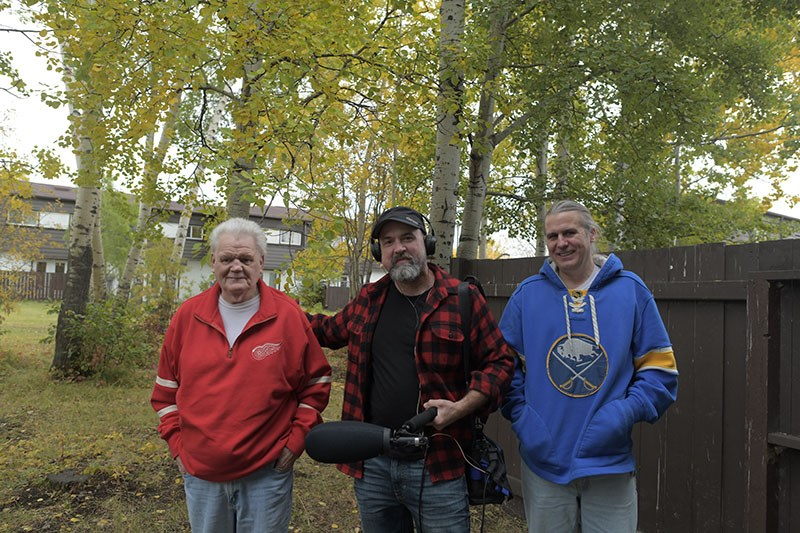 Jim Brown, left, and Trevor Brown, right, with David Ridgen, centre, producer of CBC's Someone Knows