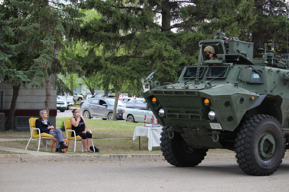 It's a special moment for Virden's centenarian, as a motorcade including CFB Shilo rolls by his home on June 1.