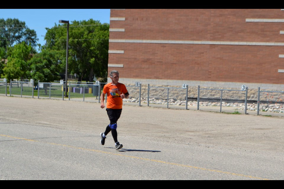 Rick Fall runs past Virden Junior High on his cross Canada run to bring awareness to excellent programs to help kids with cancer. His aim - to raise $300,000, to be split between Make-a-Wish Canada and Childhood Cancer Canada.