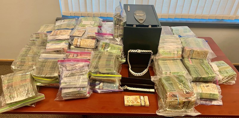More than $2 million and 20 grams of cocaine was seized by police in an investigation that included