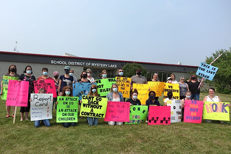 Members of United Steelworkers Local 8223, which represents non-teaching support staff at the School