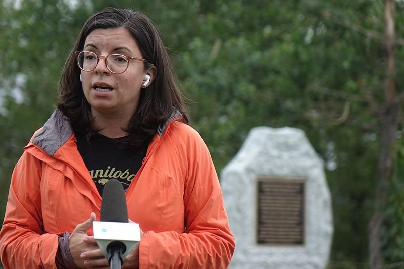 Churchill-Keewatinook Aski NDP candidate Niki Ashton speaks near a monument to residential school su