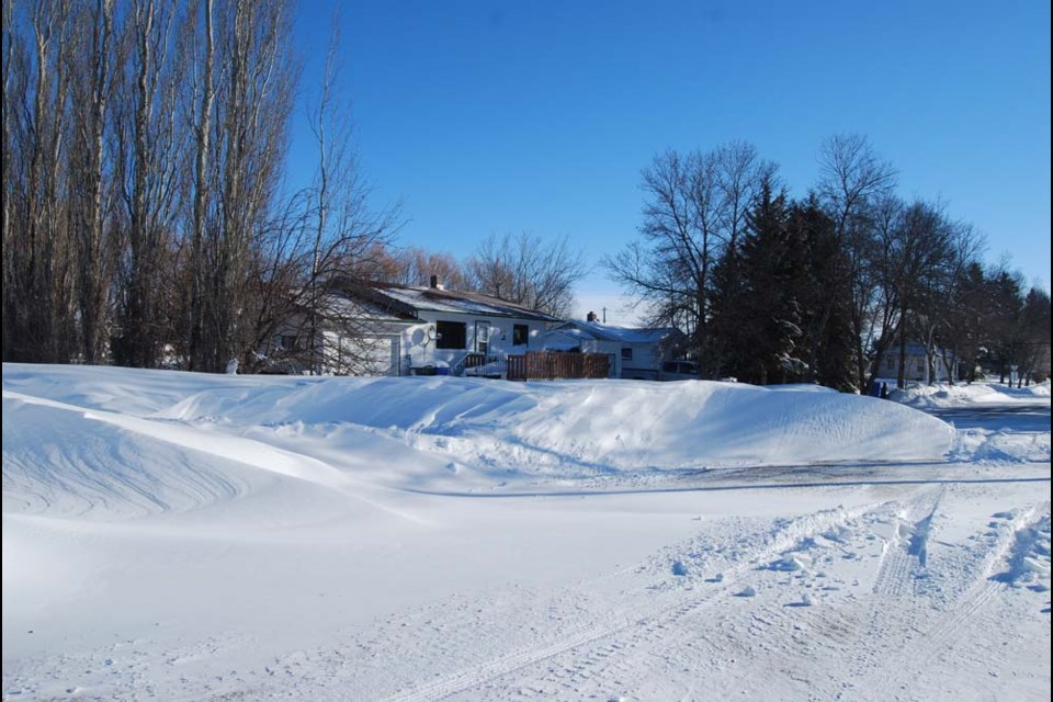 Large snowbanks, like this one on Roslyn Road in Canora, developed during the winter blizzard that struck the area on March 6 and 7