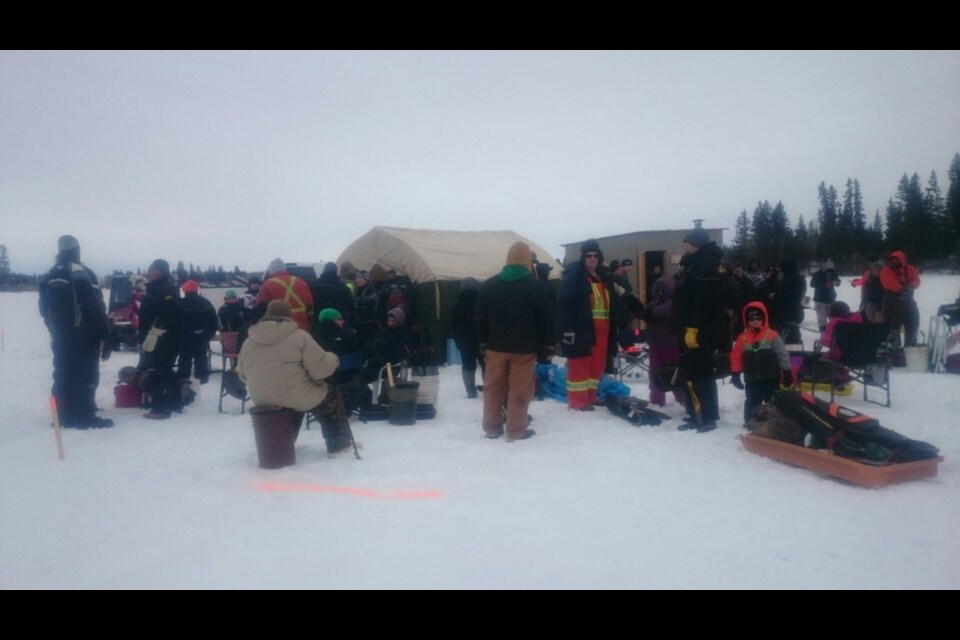 Avid fishermen gathered on the ice prior to the beginning of the Nelson Lake ice fishing derby on March 18.