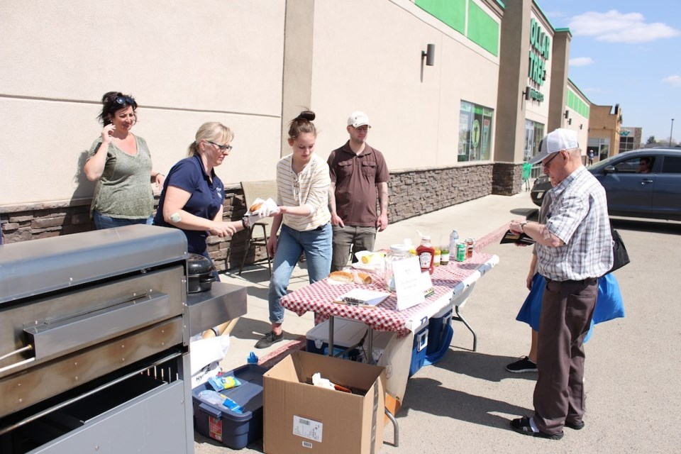 A barbecue in support of the Brayden Ottenbreit Close Cuts for Cancer was held on May 12 in front of the Bell Store.