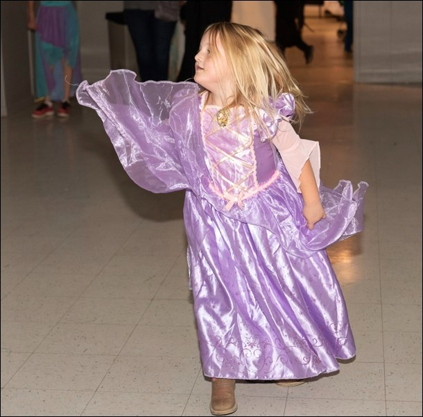 Breanna Rodness dances to music on the dance floor.