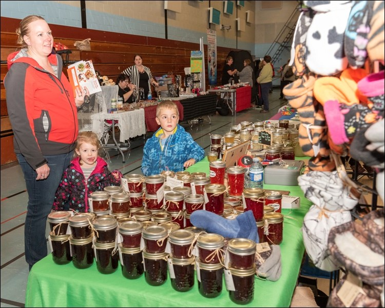 A family shops for homemade jelly by Kelly Schmidt