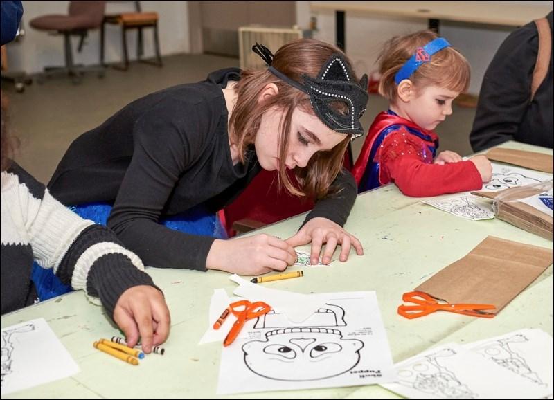 Participants colour puppets.