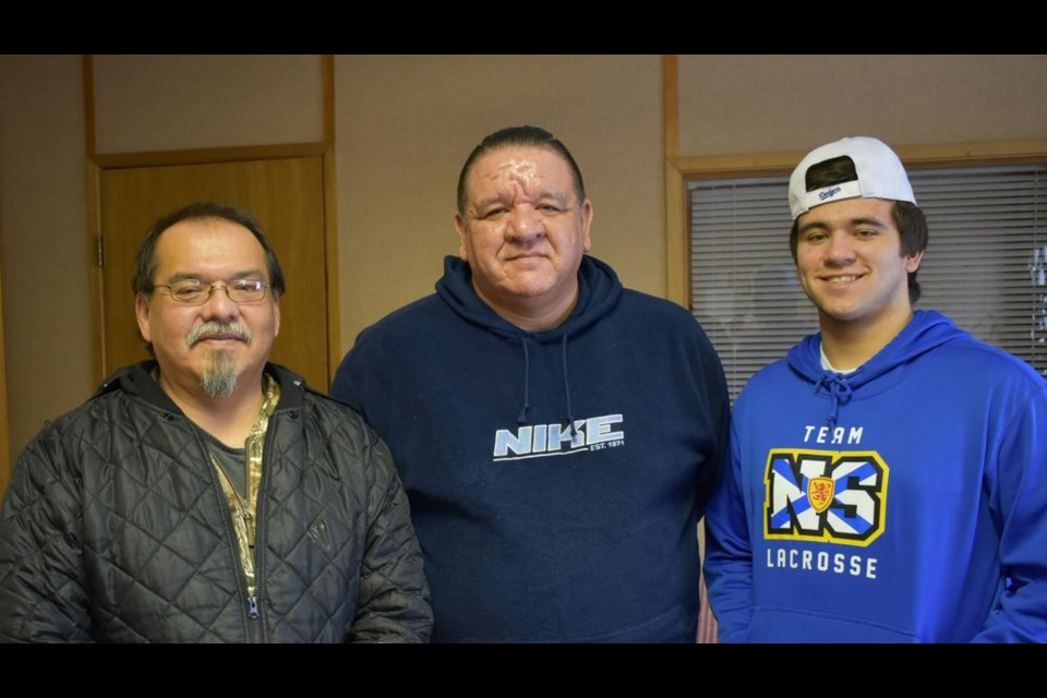 Dakota Morrisey, right, of Dartmouth, N.S., had the opportunity to visit the Keeseekoose Chief's Education Centre (KCEC) on January 21, and give a presentation on the game of lacrosse. With him were Steve Morrisey (centre), his father and George Musqua, Steve's cousin, of Keeseekoose First Nation.