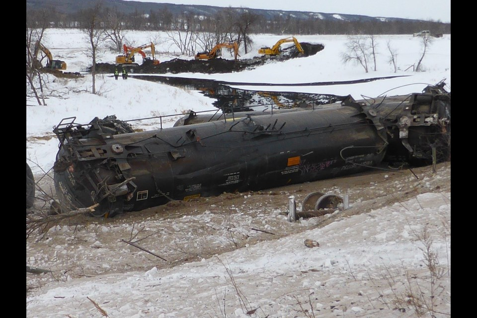 Water, and oil, flows downhill, and a team of excavators worked to stop the oil from flowing to the bottom of the Assiniboine River valley, and the river it contained.