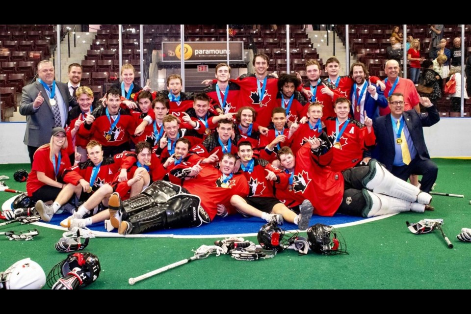 Team Canada celebrates after winning the gold medal at the 2019 World Junior Lacrosse Championships. Photo submitted
