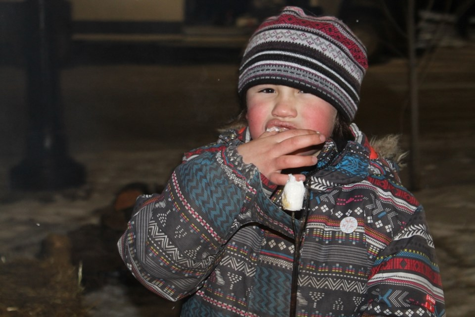 Jorja McFarlane eating a roasted marshmallow at the Nipawin Christmas tree lighting on Dec. 5. Photo by Jessica R. Durling