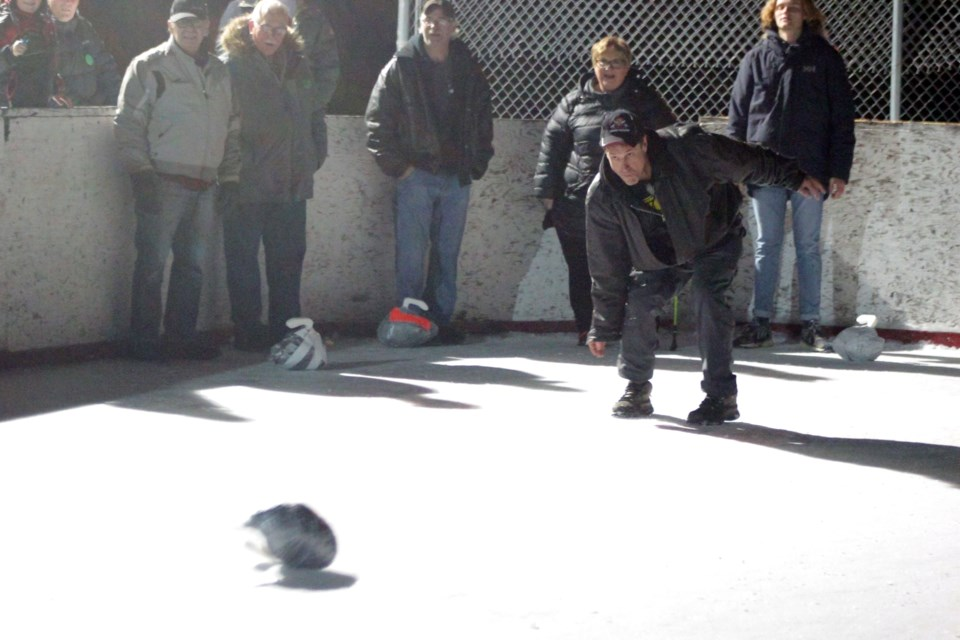 """Denare Beach village councillor Scott McCullum throws a """"stone"""" during the council challenge at the annual Turkey Curling World Championships. Councils from Flin Flon, Creighton and Denare Beach each took part in a special round robin sub-tournament. - PHOTO BY ERIC WESTHAVER"""