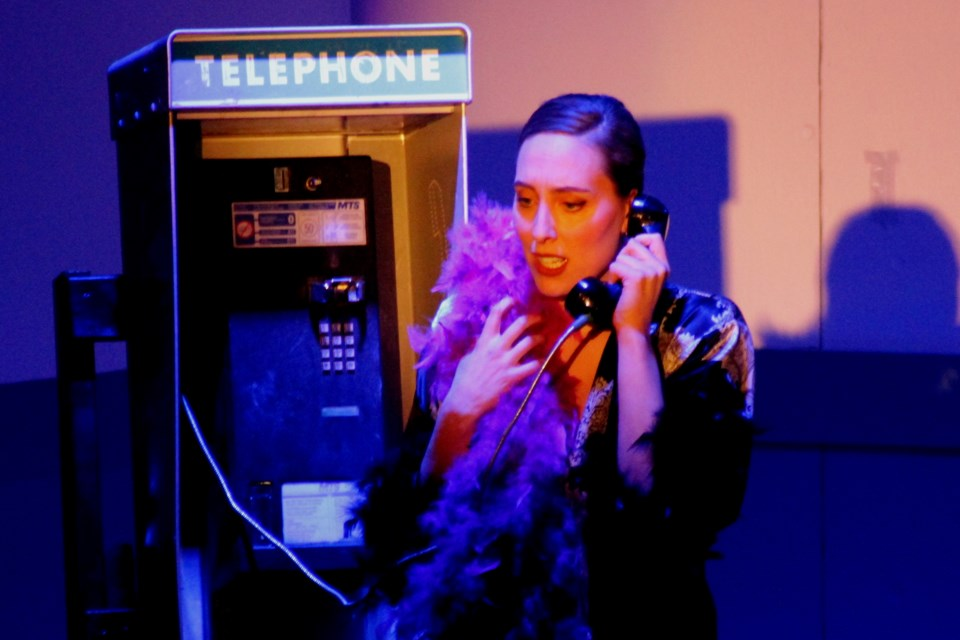 HELLO, OPERATOR: Cathy (Landice Yestrau) makes a call from a phone booth during the March 14 Ham Sandwich production of Shock Corridor, a stage adaptation of the 1963 Sam Fuller film of the same name. - PHOTO BY ERIC WESTHAVER