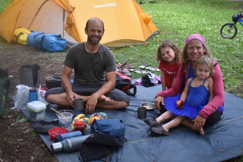 Camping at Madge Lake last week was a family of nomads, originally from Switzerland, who are travelling around the world by bicycle. From left are: Xavier, Nayla, Céline and Fibie Pasche.