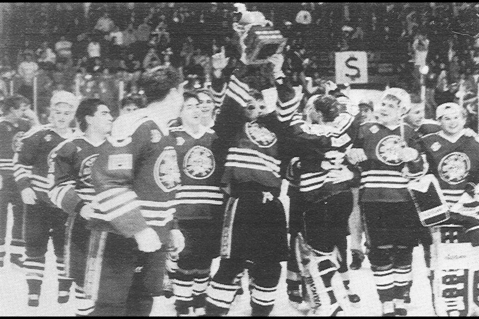 The 1993 Flin Flon Bombers hoist the SJHL championship trophy after a hard-fought Game 7 win against the Melville Millionaires. The triumph stands as the Bombers' last league title. Photo from Reminder archives