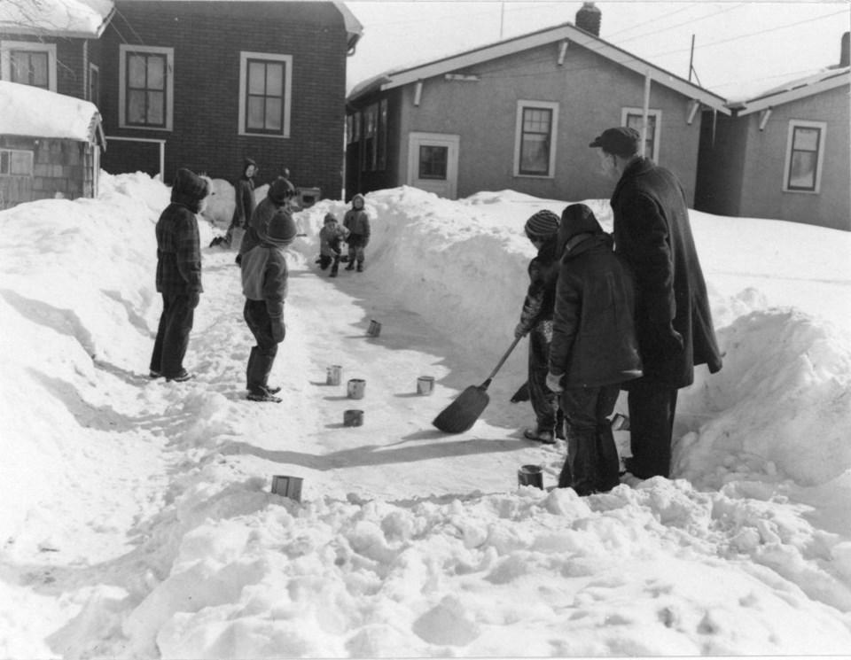 A vintage photo of children curling. Provincial Archives of Saskatchewan