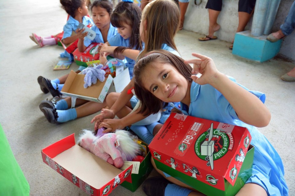 Children in Costa Rica and Senegal checking out their Canadian-packed Operation Christmas Child shoe