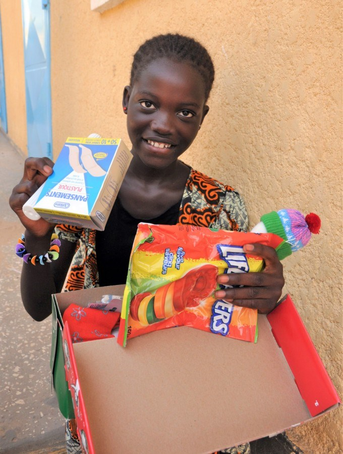 A child in Senegal checking out their Canadian-packed Operation Christmas Child shoebox. Photo submi