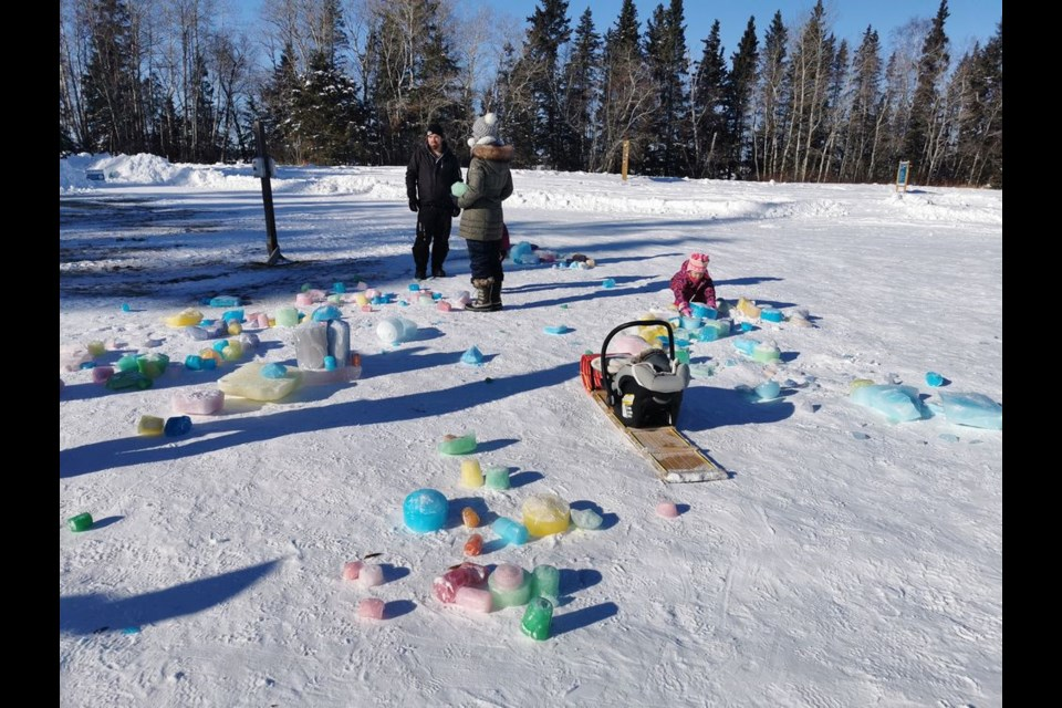 Blocks of ice that had been tinted with food colouring became children's building blocks for fairy ice castles. The winter scene at Duck Mountain Provincial Park attracted a number of local families over the holiday long weekend.