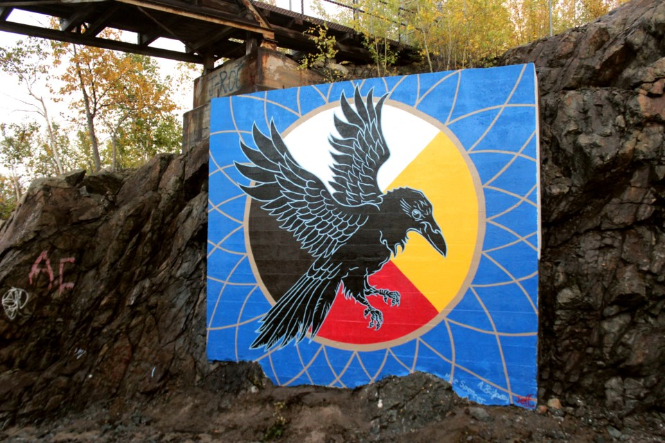 The first piece produced by the Pineroot Mural Festival group, located just off the Perimeter Highway, shows a traditional First Nations medicine wheel and a raven. The group behind the piece is now organizing two pieces to be painted in Flin Flon this summer. - FILE PHOTO