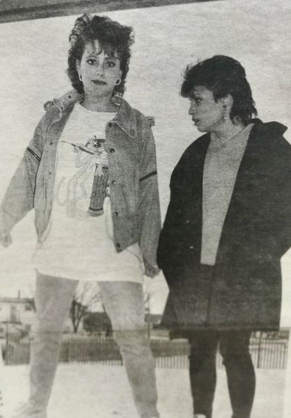 April 20, 1986 – Involved in off-stage theatrics as KCI students prepared for their Drama-in-Review dress rehearsal, Lisa Pister and Donna Pfeifer demonstrated how Vogue magazine models might be photographed.