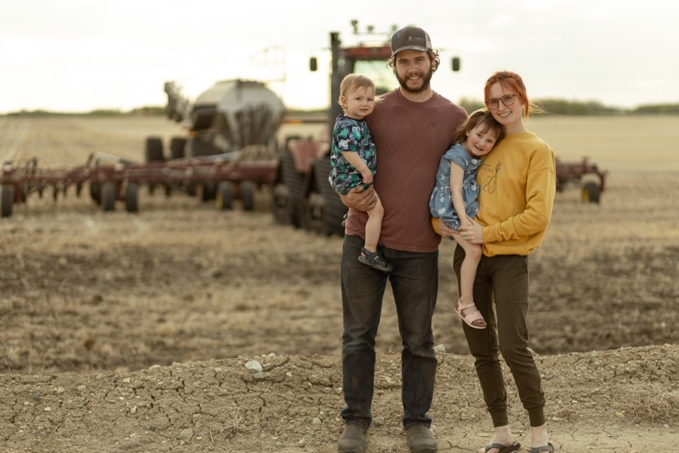 Dylan, Samantha and their children Jack and Haven Breault at the end of another long seeding day. Photo courtesy of SafeHaven Photography