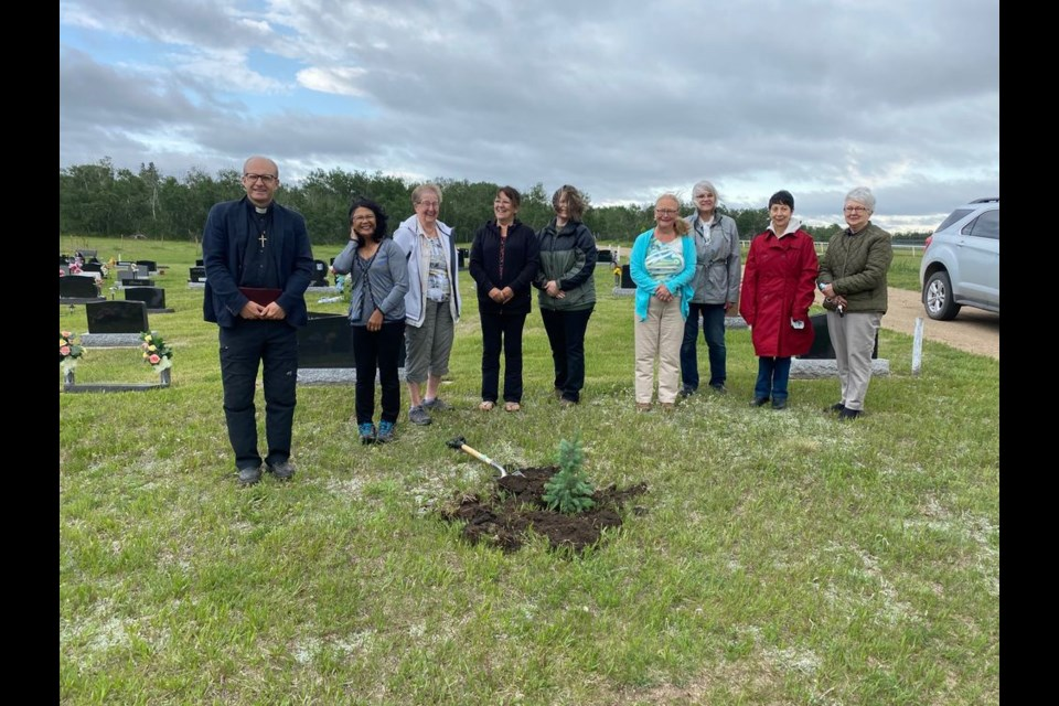 The Preeceville branch of the Catholic Women's League of Canada planted a spruce tree sapling at the Roman Catholic Cemetery in the Preeceville Cemetery in recognition and celebration of the national Catholic Women's League of Canada centennial on June 10. Local members, from left, were: Father Michal Pajak, Nellie Knihniski, Bea Sekel, Lorraine Strijak, Arlene Lingl, Kathleen Pitt, Donna Balaywder, Norma Appel and Zita Serhan.