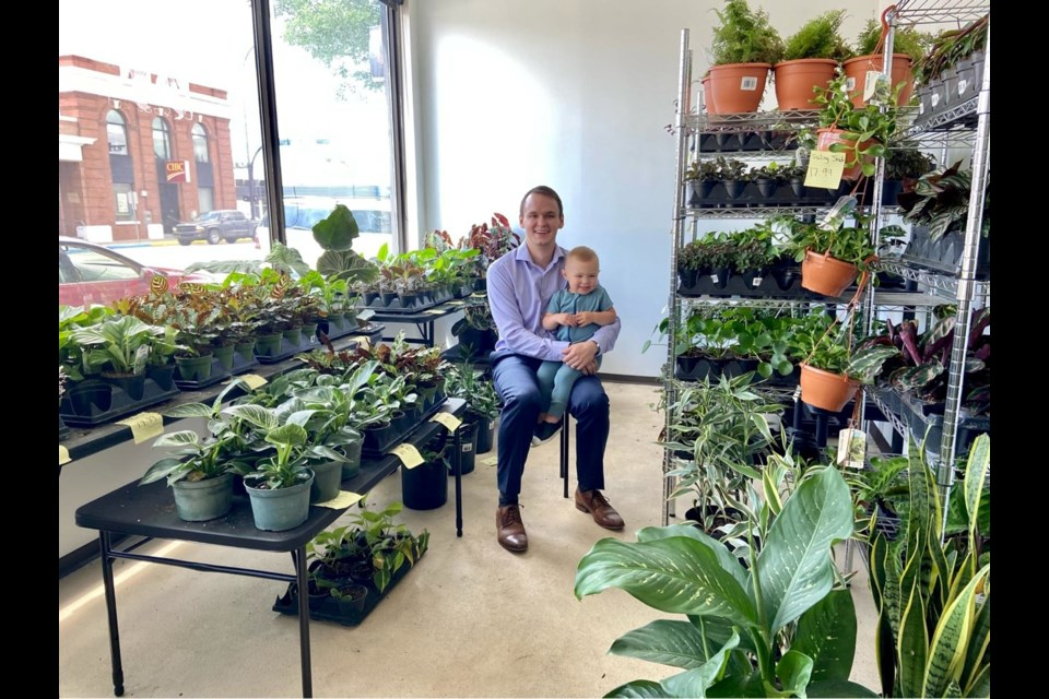 The owner of the Plant Bench, Kellan George, at the store with his son Hayes. Picture by Shelaia George