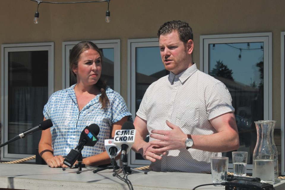 Opposition critic Aleana Young. Left, joined restaurant owner Josh McLean (R) outside his business,