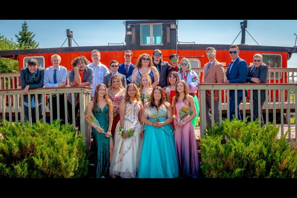 """""""Only those who dare to fail greatly can achieve greatly."""" ~ Robert Kennedy. This quote was selected by the 2021 graduating class of the Kamsack Comprehensive Institute. The students celebrated their achievements of an extraordinary and challenging pandemic year by dressing in formal wear to parade through town and pose for photos at Kamsack's Trackside Gardens on June 29. -Photo submitted by Dustin Wilson"""
