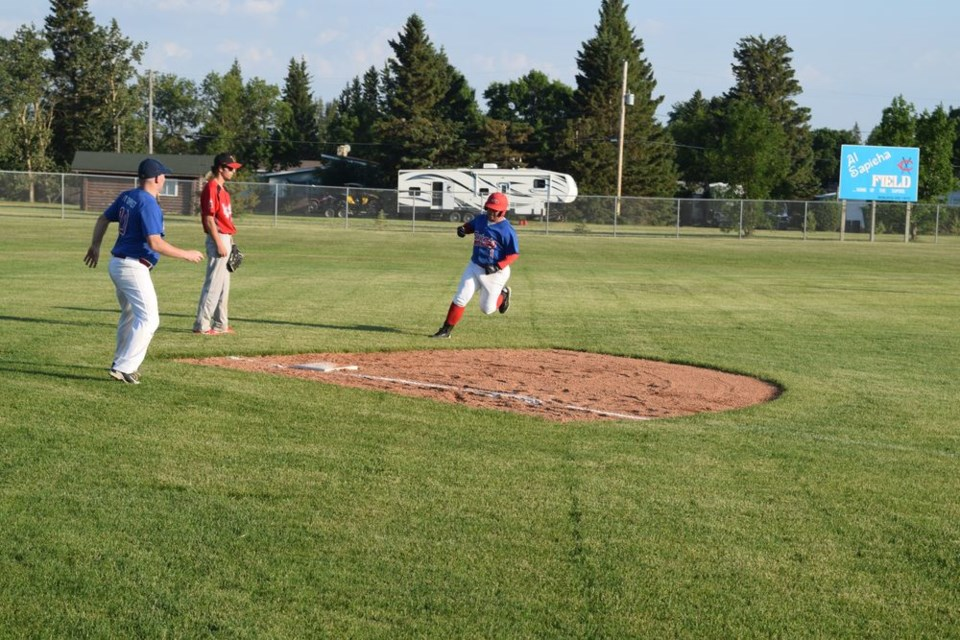 Leadoff hitter Evan Rostotski rounded third on his way to scoring a run in the win over Yorkton, with plenty of encouragement from third base coach Greg Andreychuk. Rostotski spearheaded the Supers attack with a team-leading three hits.