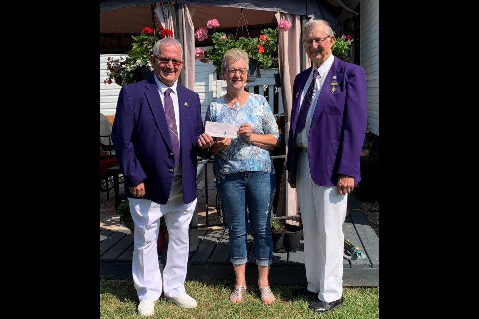 Foundation Chairman Joe Calder and Senior Homes Chairman Tony Koval present 50/50 Prize to Heather Buziak of North Battleford. Photos submitted