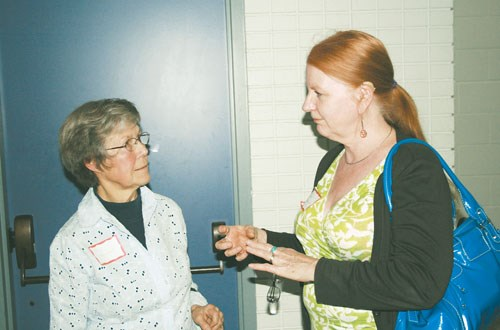 Nora Stewart, left spoke about wildflowers at a symposium in Yorkton, as well as to  Bonnie Rushowick during a break.