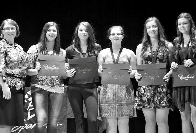 AnnaLee Placatka, left, presented the awards of excellence to, from left: Kaylie Bowes, Lexie Tomochko, Kali Wyllychuk, Jaelyn Dietz and Cassidy Aker.