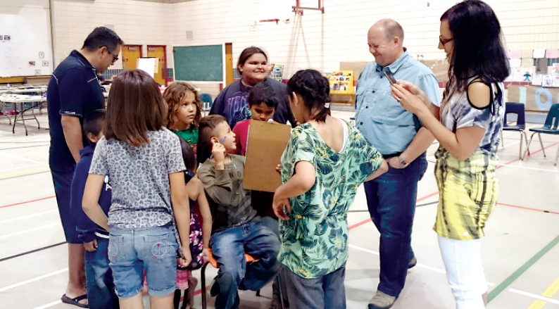 Among the adults who were involved with the children in a three-week literacy camp at Cote First Nation this summer, from left, were (standing) Corey O'Soup, assistant deputy minister of Aboriginal and Métis affairs; Kevin Fenwick, deputy minister of justice, and Rhonda Taylor, regional manager of Frontier College in Manitoba and Saskatchewan.