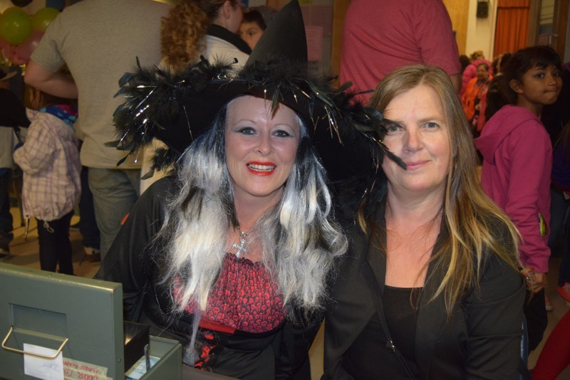 Tending the admission table at the KCI Fun Night on October 27 were Jane Hoy and Lorraine Chutskoff.