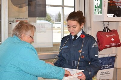 Gracie Paul accepted a donation from a customer shopping at the Gateway Co-op on October 29 as part of the Royal Canadian Legion's poppy campaign, which is supported by the Canora Air Cadets.