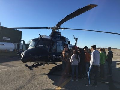 A Canadian Armed Forces helicopter landed at the airport for a short time and allowed the cadets to tour the helicopter.
