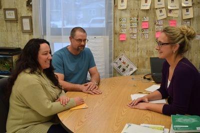 In the photo, Katherine Rewakowski, left, and her husband Darcy met with Jennifer Prychak.