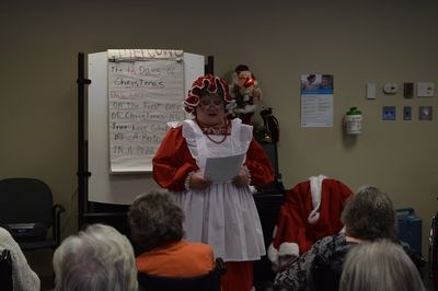 Mrs. Claus read a story to the residents of the Gateway Lodge about the troubles Santa faced preparing for Christmas in the modern age.