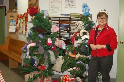 Hazel Urbanoski posed with the mitten tree.