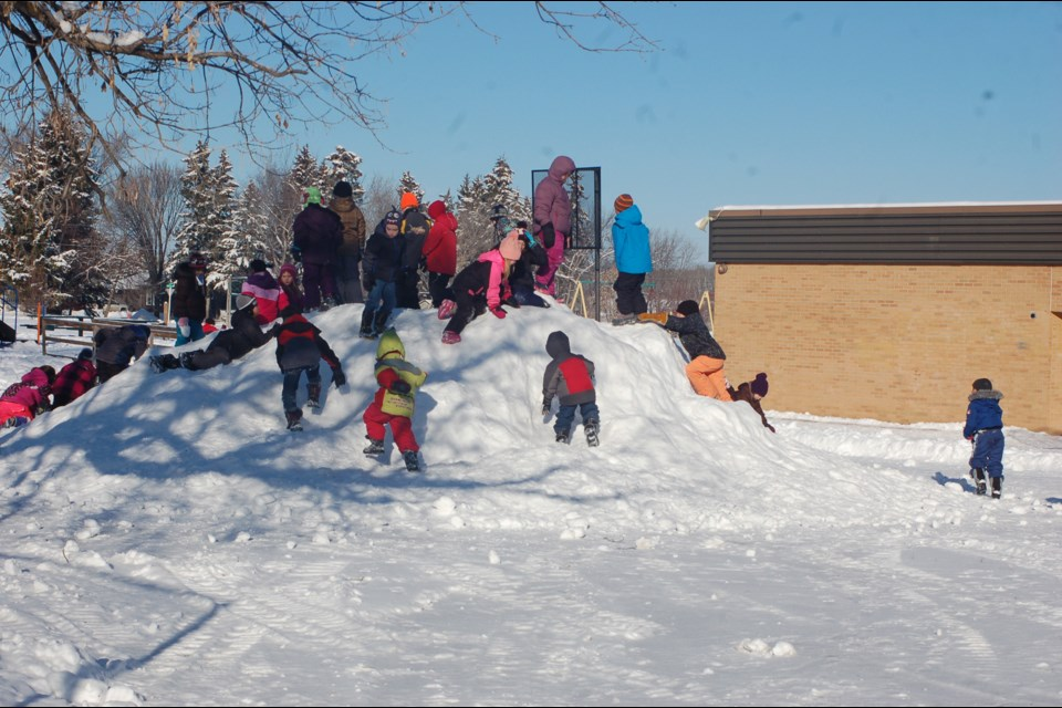 Many children enjoyed scrambling on the snow hill at the Preeceville School yard on January 27.