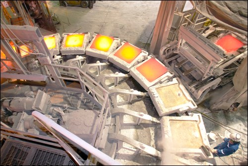 Inside the copper smelter in the 2000s, with copper anodes being cast.