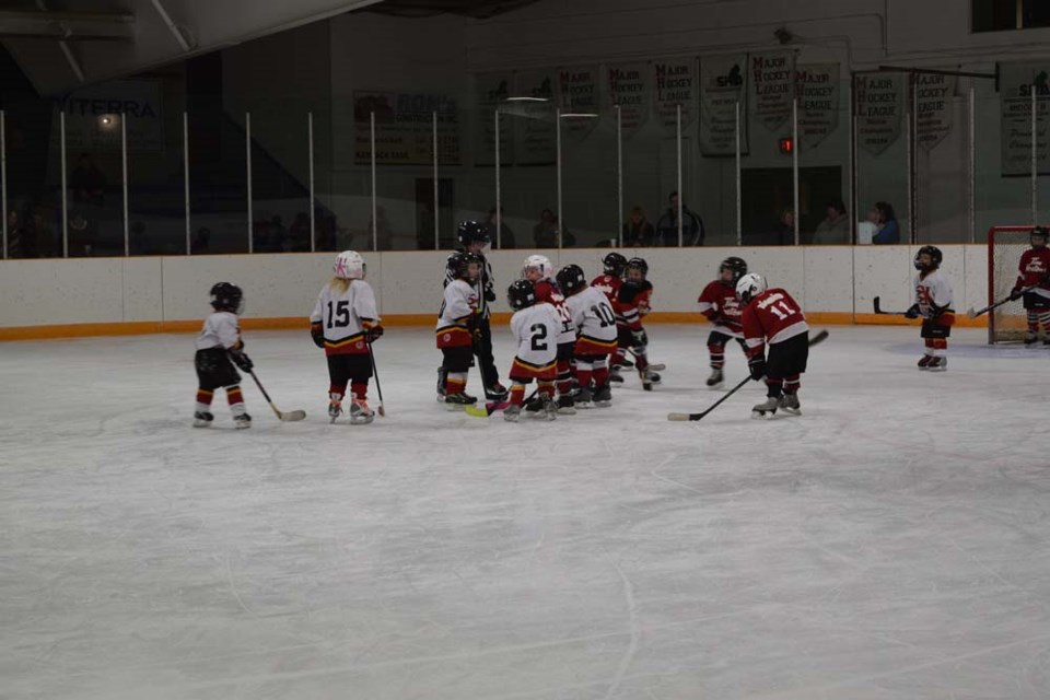 The puck dropped during the exhibition game between the IP Flyers in white jerseys and the IP Cobras, wearing red.