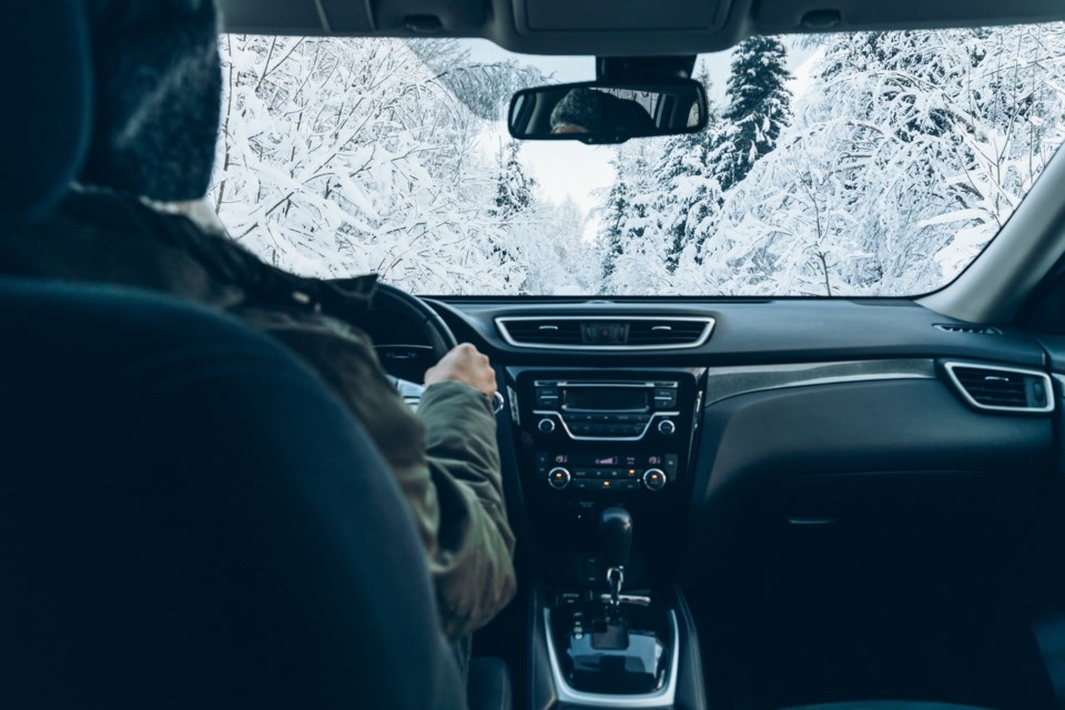 Article8B-Man-drives-a-car-on-snow-winter-road-6K2XKGV